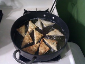 Sambusas frying on the stove